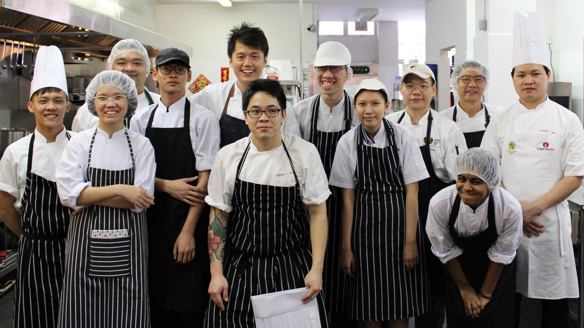 Chef Immanuel Tee (the tallest one in the back) with culinary students of Assumption Pathway School.
