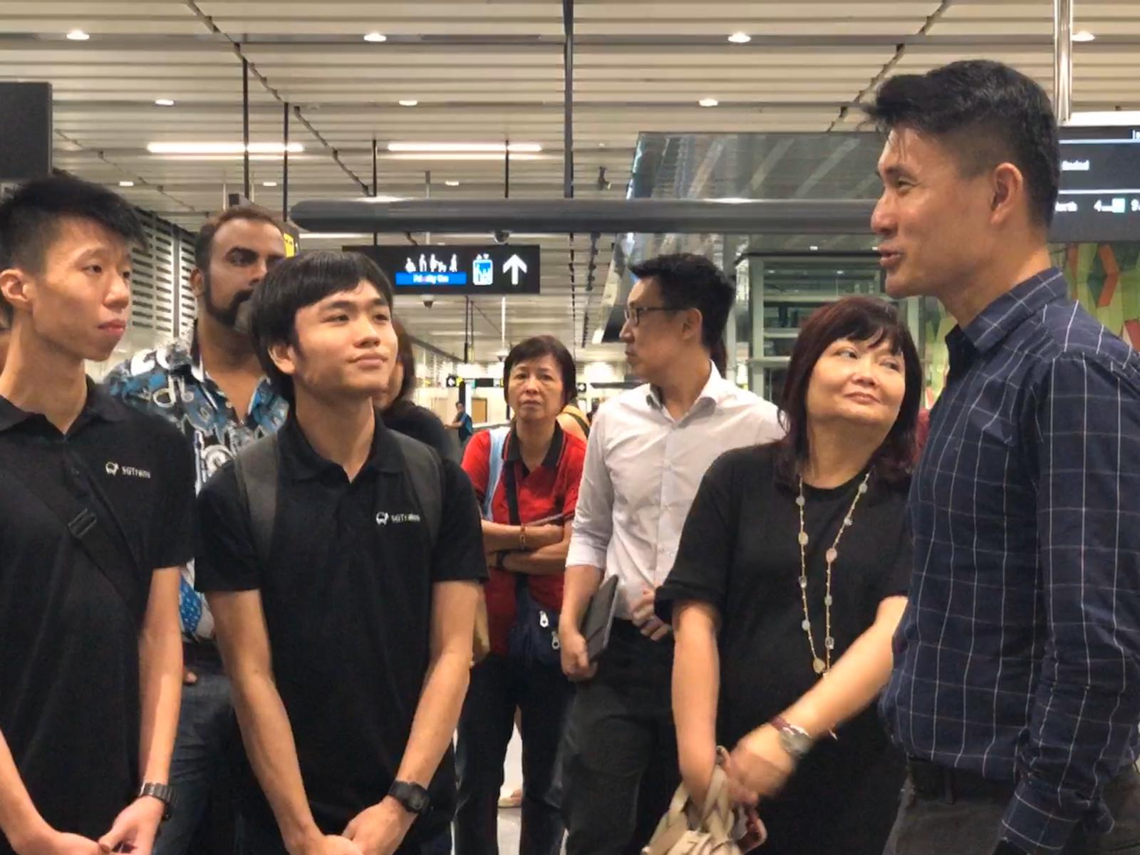 Senior Parliamentary Secretary for Ministry of Transport and Culture, Community & Youth Baey Yam Keng (extreme right) and train enthusiast Matthew Ng (second from left) discuss the old system map.
