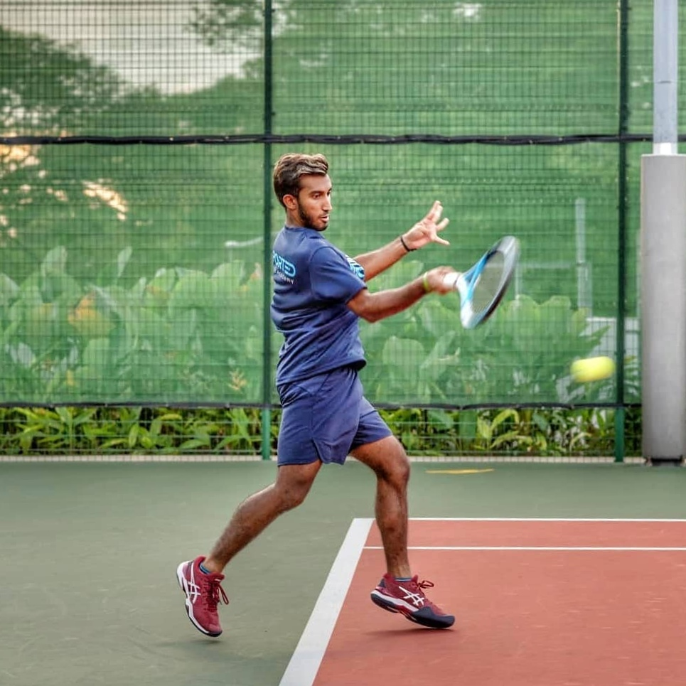 Singapore Tennis Player Serves His Best On And Off The Court