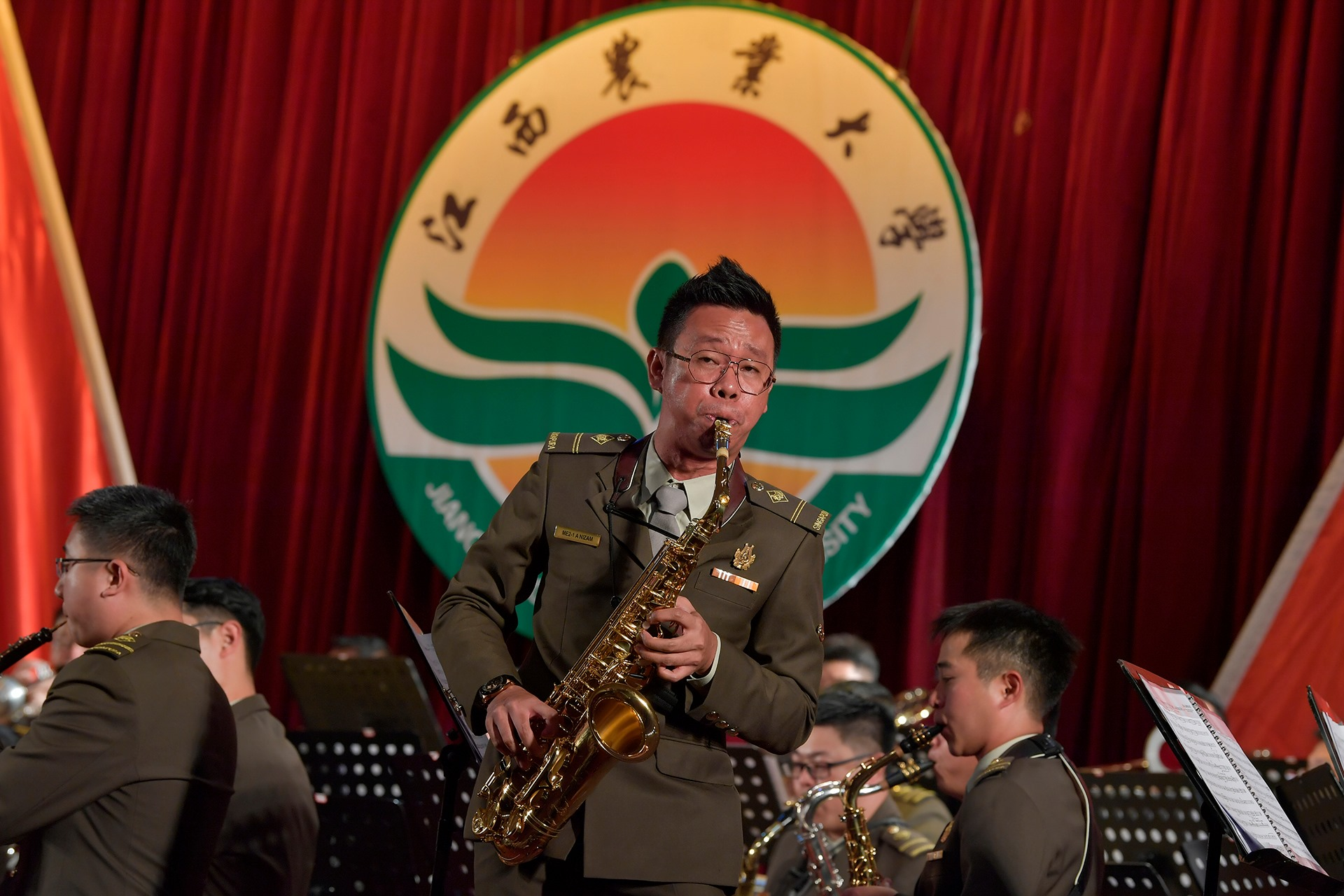 Performing a saxophone solo at the university concert in Nanchang, Jiangxi, China.